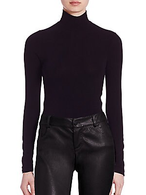 "Image of A back zipper lends a hint of edge to this of-the-moment turtleneck infused with a hint of stretch for the perfect fit Turtleneck Long sleeves Exposed back zip About 20"" from shoulder to hem Polyester/rayon/elastane Hand wash Made in USA of imported fabri"
