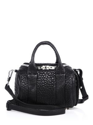 """Image of Adding a downtown-cool element to your everyday ensemble, a classic duffel shape defines this Alexander Wang style, finished with silvertone studs. Double top handles, 3.5"""" drop. Removable, adjustable shoulder strap, 20""""-24"""".Double zip closure. Stud-cover"""