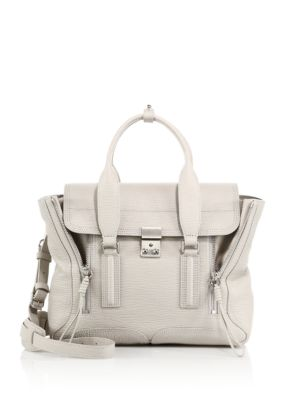 """Image of Crafted from signature textured leather, this iconic style features expandable side zippers and a removable shoulder strap for a customizable style. Double top handles, 4"""" drop. Removable, adjustable shoulder strap, 16""""-20"""" drop. Push-lock flap closure. T"""