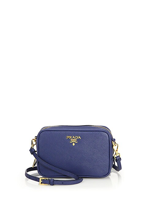 """Image of A petite crossbody style crafted of richly textured Saffiano leather and designed with room for a smartphone, credit cards, lipstick and more. Finished with the Prada insignia cast in a radiant goldtone. Removable, adjustable crossbody strap, 22.5""""-24.5"""""""