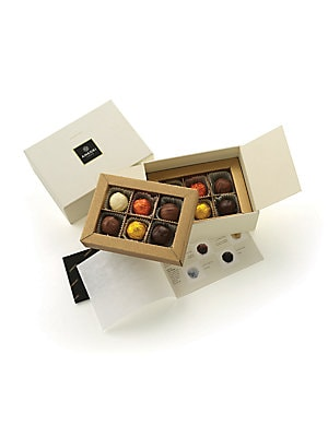 Image of An assortment of fine pralines made in Italy. Includes 12 pralines 2 Capriccio grappa/alcohol 2 Delizioso hazelnut cream 2 Tartufo hazelnut/almond 2 Vin Santo vin santo/alcohol 2 Passione rum 2 Solare zabaone/alcohol 4.25 oz. Shelf life: 6 months Made in