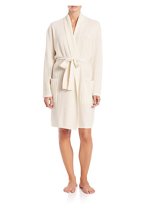 """Image of Essential robe cast in supremely soft cashmere. Shawl collar. Drop shoulders. Long sleeves. Self-tie closure. Patch pockets. About 57"""" from shoulder to hem. Cashmere. Dry clean. Imported. Model shown is 5'10"""" (177cm) wearing size Small."""