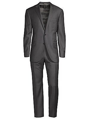 """Image of This smart suit includes jacket and pants tailored from wool fabric. Regular-fit. Virgin wool. Dry clean. Made in Italy. JACKET Notch lapels Long sleeves Buttoned cuffs Button front Chest welt pocket Waist flap pocket About 29"""" from shoulder to hem PANTS"""