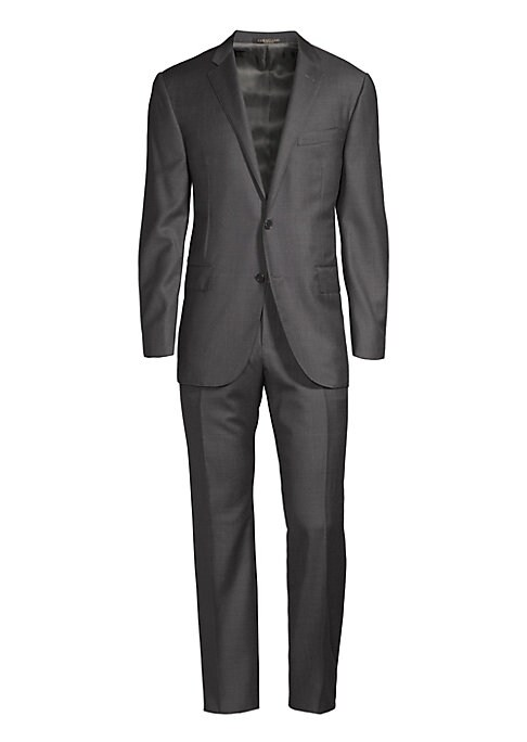 """Image of This smart suit includes jacket and pants tailored from wool fabric. Regular-fit. Virgin wool. Dry clean. Made in Italy. JACKET. Notch lapels. Long sleeves. Buttoned cuffs. Button front. Chest welt pocket. Waist flap pocket. About 29"""" from shoulder to hem"""