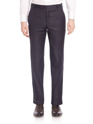 """Image of Expertly tailored trousers rendered from fine wool. Belt loops. Zip fly with button closure. Slash pockets. Back buttoned welt pockets. Leg opening, about 16"""".Rise, about 10"""".Wool. Dry clean. Made in USA."""