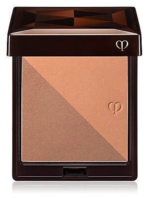 Image of A bronzing powder duo and brush with two different color tones and textures that bathe skin in sun kissed radiance for a perfect glow. 0.35 oz. Made in Japan. Ask the experts. Our Beauty Advisors are here to help. Send an email to CleDePeauBeautySpecialis