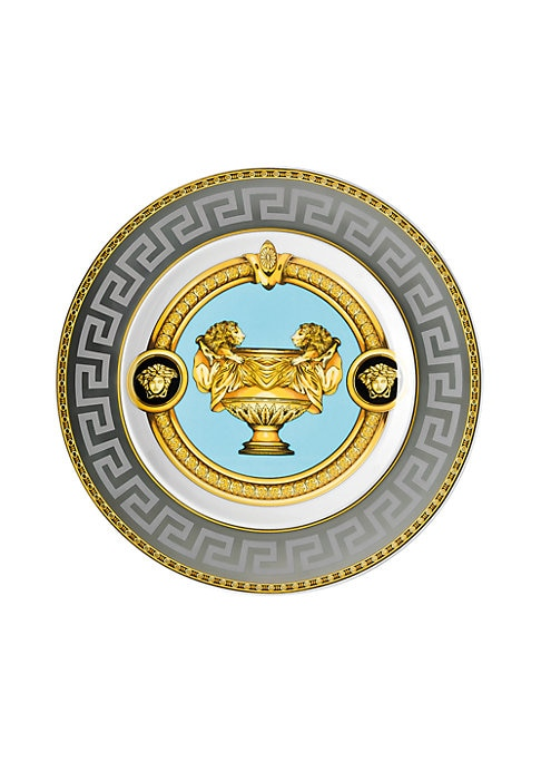 """Image of From the Prestige Gala Collection. Inspired by an iconic Versace print with imposing lions, this exquisite pattern features baroque elements over a Greek key motif, enriched with gold and platinum accents.7""""W X 7""""H.Porcelain. Hand wash. Imported."""