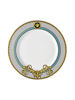 "Image of From the Prestige Gala Collection. Inspired by an iconic Versace print with imposing lions, this exquisite pattern features baroque elements enriched with gold and platinum accents. 8.5""W X 8.5""H Porcelain Hand wash Imported. Gifts - Tabletop. Versace."