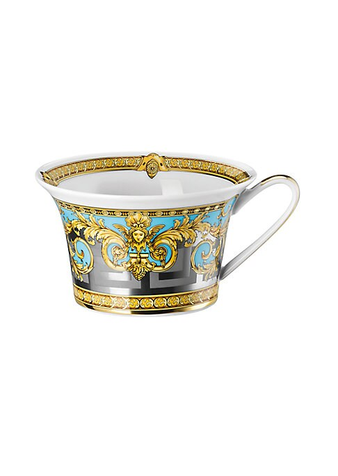 Image of From the Prestige Gala Collection. Inspired by an iconic Versace print with imposing lions, this exquisite pattern features baroque elements over a Greek key motif, enriched with gold and platinum accents.7 oz. capacity. Porcelain. Hand wash. Imported.