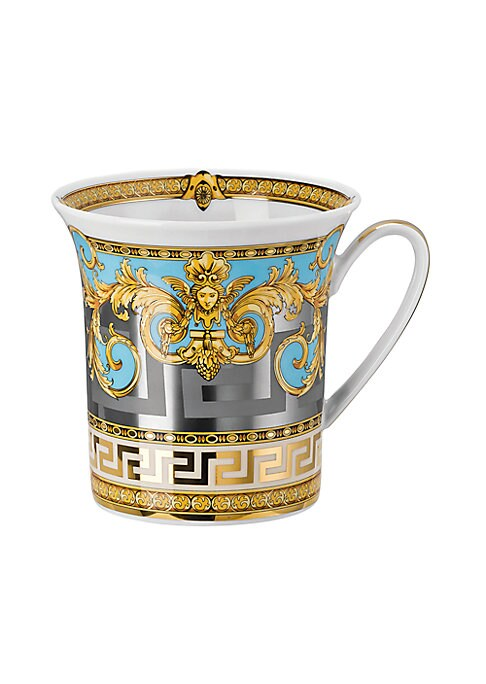 """Image of From the Prestige Gala Collection. Inspired by an iconic Versace print with imposing lions, this exquisite pattern features baroque elements over a Greek key motif, enriched with gold and platinum accents.10.5""""W X 10.5""""H.Porcelain. Hand wash. Imported."""