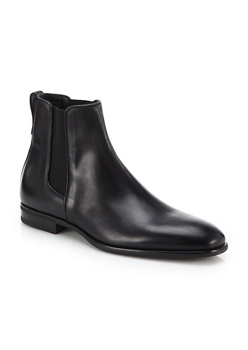 Image of Form meets function on this weatherproofed Chelsea boot designed in a crisp, polished silhouette. Leather upper. Waterproof. Weatherproof. Leather lining. Padded insole. Flexible rubber sole. Made in Italy.