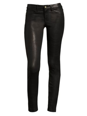 """Image of The classic, streamlined silhouette of this five-pocket skinny jean is enhanced with leather for maximum luxury. Belt loops. Zip fly with button closure. Five-pocket style. Rise, about 8.5"""".Inseam, about 29"""".Leg opening, about 10"""".Leather. Dry clean by le"""