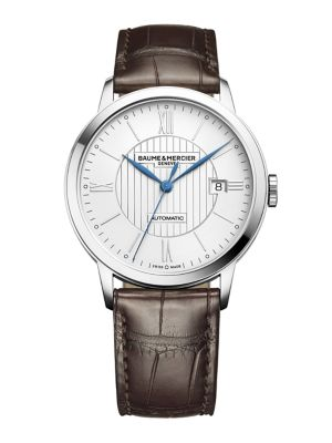 Image of From the Classima Collection. A tribute to classic watch design with impeccable attention to detail, the Classima is cast in a combination of sleek stainless and smooth, richly dyed brown alligator, containing automatic movement visible through the transp