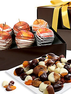 Image of A divine assortment of fruit is lovingly hand-dipped in decadently creamy Belgian chocolate. Includes: six chocolate-dipped gala apples and an assortment of dried apricots, pineapple, dates and figs Serves: Seven Covered in Belgian chocolate Arrives in an