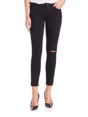 "Image of A rip at the knee accentuates the right-now appeal of this cropped skinny jean in a jet black wash. Belt loops. Zip fly with button closure. Five-pocket style. Distressed detail. Cropped hem. Rise, about 10"".Inseam, about 28"".Leg opening, about 10"".Cotton"