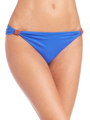 Image of Low-rise style with ruched sides and hardware. Stretch bottom. Ruched sides with hardware. Nylon/elastane. Hand wash. Imported. Please note: Bikini top sold separately.