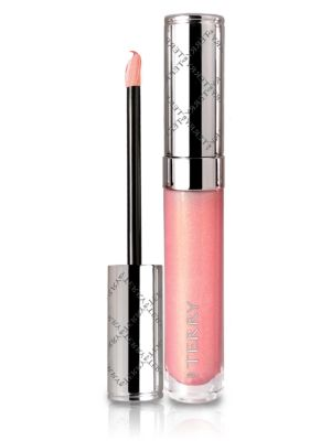 """Image of This ultra-shiny, lift-firming, volumizing lip lacquer plumps up the smile with longlasting glow. The age-defense Lumilip? technology combines nutri-regenerating ceramides, hydra-filling hyaluronic acid, collagen-stimulating peptide, plumping """"Kiss Me Qui"""