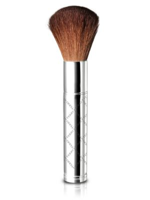 Image of This ultra silky brush perfectly adapts texture and color to provide an even application of loose powders, compact foundations, or bronzers. Made of natural goat hair. Imported.