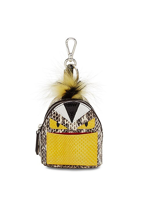 Image of Miniature snakeskin charm with plush fur detail. Silvertone lobster clasp and key ring. Snakeskin. Fur type: Natural fox. Fur origin: Finland. Fur type: Dyed nutria. Fur origin: Argentina. Made in Italy.