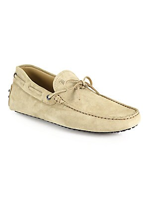 Image of Classic drivers with tie detail Suede upper Leather lining Pebbled rubber sole Made in Italy. Men's Shoes - Tods Mens Footwear. Tod's. Color: Natural. Size: 6 UK (7 US).