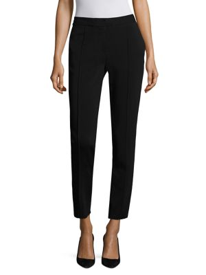 "Image of Stretch pant idyllic for the office and after hours. Banded waist. Zip fly with hook-and-bar closure. Side slash pockets. Pleated front. Back welt pockets. Rise, about 11"".Inseam, about 31"".Cotton/elastane. Dry clean. Made in USA of imported fabric. Model"