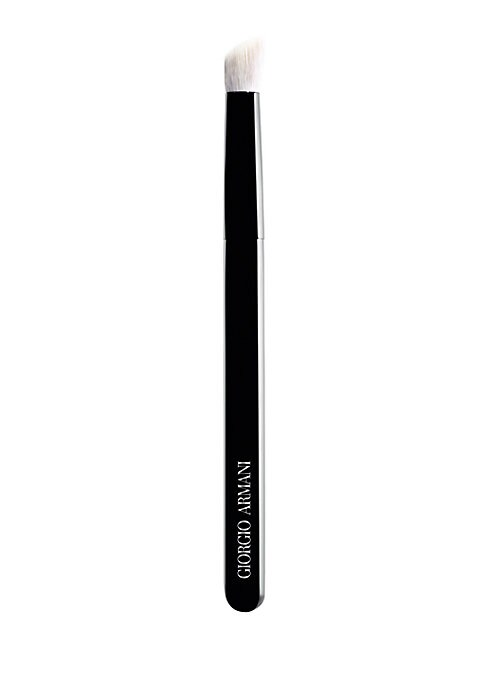 Image of This new Armani Maestro Angled Eye Brush was created with the perfect slant to bring depth, and to accentuate the eye. This brush has better pick up, adherence, and is perfect for contouring the eye. Avoids dusting during application. Made of goat hair. M