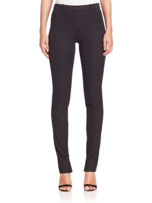 "Image of Legging-like pant of smooth stretch cotton. Belt loops. Concealed side zip. Vented cuffs. Rise, about 11"".Inseam, about 30"".Cotton/elastane. Dry clean. Made in UK. Model shown is 5'10"" (177cm) wearing US size 4."
