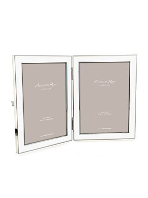 """Image of From the Double Frames Collection. Charming double frame capturing sweet memories. Accommodates two 5""""W x 7""""H photographs Overall: 6""""W x 8""""H x 1""""D Silver-plated zinc/enamel Spot clean Imported. Gifts - Frames And Leather Acces > Saks Fifth Avenue. Addison"""