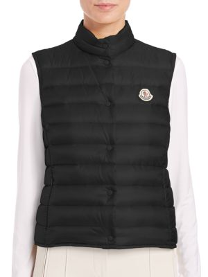 "Image of Warm puffer vest in slim fit. Stand collar. Sleeveless. Snap front. Side zip pockets. About 25"" from shoulder to hem. Nylon. Fill: Down/feathers. Dry clean. Imported. Model shown is 5'10"" (177cm) wearing size Small."