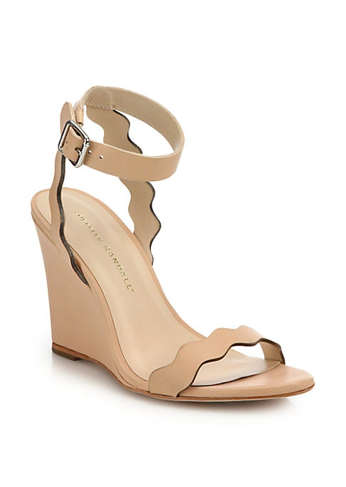 """Image of Scalloped straps elevate sleek leather wedge. Wedge heel, 3.5"""" (90mm).Leather upper, lining and sole. Adjustable ankle strap. Padded insole. Made in Brazil."""