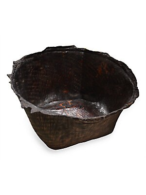 "Image of Antique container for a beautiful storage solution. Aged goatskin with dark brown polish. 22""-24""W x 10""-12""H Natural organic rim Spot clean Imported. Gifts - Decorative Home. Andrianna Shamaris."