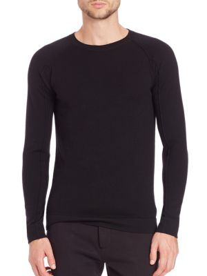 Image of Fine wool shapes this crewneck pullover. Long sleeves. Ribbed cuffs and hem. Wool. Dry clean. Imported of Italian fabric.