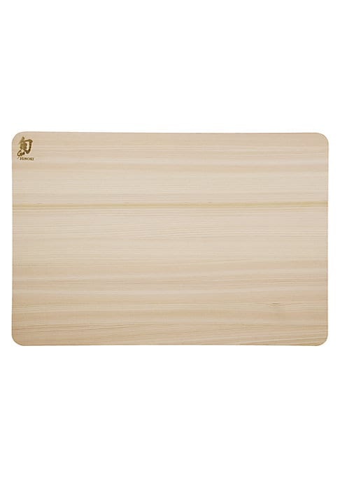 """Image of From the Shun Accessories Collection. Japan-grown medium-soft wood cutting board.8.25""""W X 10.75""""H X 0.5""""D.Hinoki. Hand wash. Imported."""