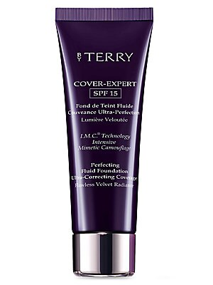"""Image of WHAT IT IS Inspired by the most advanced digital retouching technologies, this non-greasy, creamy-fluid foundation combines perfecting coverage with SPF 15 anti-UV protection. 1.18 oz. Made in Italy. WHAT IT DOES Its """"matte-stretch skin mimetic"""" texture w"""