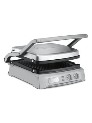Image of From the Kitchen Electrics Collection. Extra-large grilling surface with six options. Contact grill, panini press, full griddle, full grill, half grill, half griddle, top melt. Adjustable top cover with 6 presets. Removable, reversible and nonstick grill/