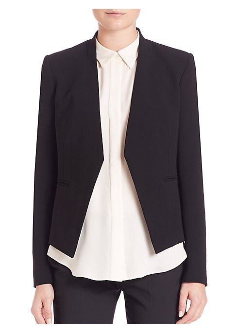 "Image of .Architectural tuxedo jacket with clean lines. Banded collar. Open front. Welt pockets. Seamed back. Lined. About 22"" from shoulder to hem. Wool/elastene."