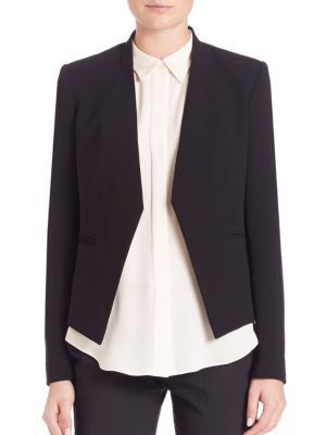 """Image of .Architectural tuxedo jacket with clean lines. Banded collar. Open front. Welt pockets. Seamed back. Lined. About 22"""" from shoulder to hem. Wool/elastene."""
