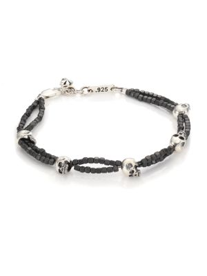 """Image of Two-strand hematite joined by detailed skull beads. Grey hematite. Sterling silver. Length, 8.75"""".Lobster clasp closure. Made in USA."""