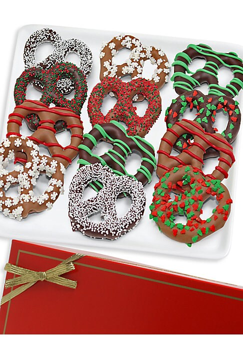 Image of 12 chocolate-covered pretzels drenched in dark, milk, and white Belgian chocolate decorated with holiday-themed toppings and candies. Serves: 12.Covered in Belgian chocolate. Arrives in an elegant gift box. Made in USA. SPECIFICATIONS. Shelf life: 30 days