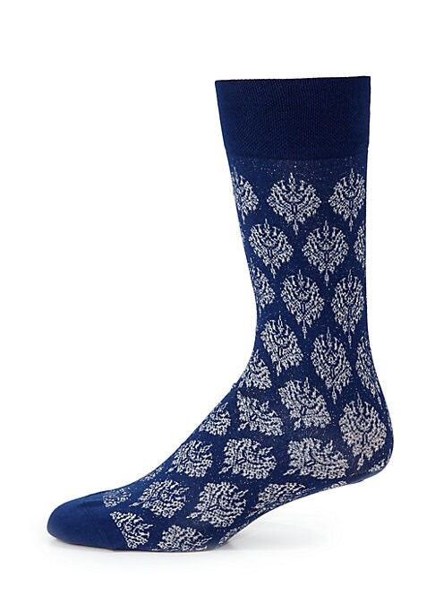 "Image of Socks with an ornate and glittering brocade pattern. Mid-calf height. Length, 19"".Cotton/nylon/polyester/spandex. Machine wash. Made in Italy."