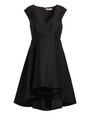 "Image of Chic party dress with a dramatic pleated skirt.V-neck. Cap sleeves. Concealed back zip. Darted bodice. Seamed waist. Pleated skirt. Fit and flare silhouette. Hi-lo hem. Lined. About 33"" from shoulder to hem. Cotton/silk. Dry clean. Imported. Model shown i"