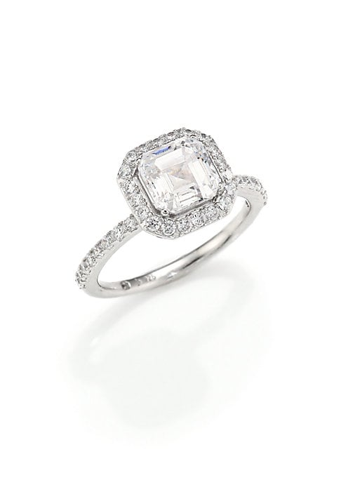 Image of EXCLUSIVELY AT SAKS FIFTH AVENUE. Timeless ring design with pave halo and band. Cubic zirconia. Rhodium-plated sterling silver. Imported.