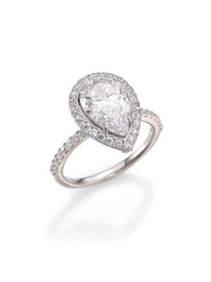 Image of EXCLUSIVELY AT SAKS FIFTH AVENUE. Stunning pear-shaped design with pave halo and band. Cubic zirconia. Rhodium-plated sterling silver. Imported.
