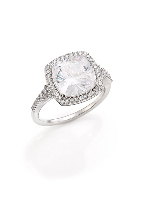 Image of EXCLUSIVELY AT SAKS FIFTH AVENUE. Stunning, faceted ring design with pave halo. Cubic zirconia. Rhodium-plated sterling silver. Imported.