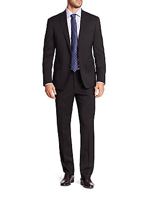 "Image of ONLY AT SAKS. Handsome solid dress staple fashioned from pure wool. Wool. Dry clean. Made in Canada. JACKET Peak lapel Two-button front Chest welt pocket Waist flap pockets Long sleeves Buttoned cuffs Dual back vents About 27"" from shoulder to hem Fully l"
