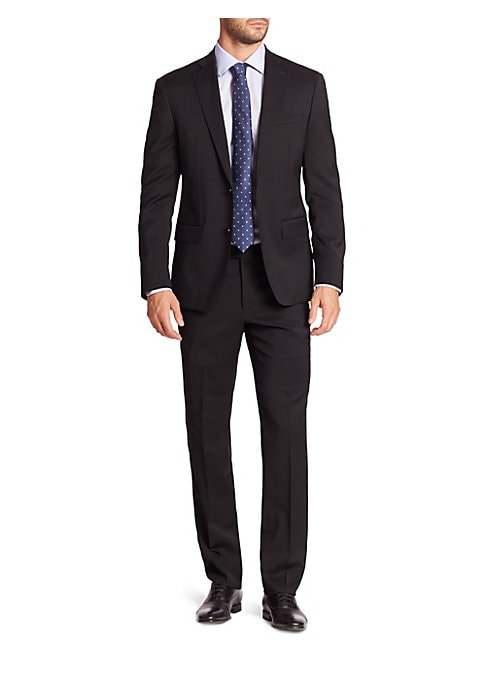 """Image of EXCLUSIVELY OURS. Handsome solid dress staple fashioned from pure wool. Wool. Dry clean. Made in Canada. JACKET. Peak lapel. Two-button front. Chest welt pocket. Waist flap pockets. Long sleeves. Buttoned cuffs. Dual back vents. About 27"""" from shoulder to"""