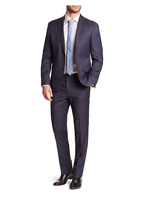 """Image of EXCLUSIVELY OURS. Clasically tailored suit cut from sharkskin-textured wool. Wool. Dry clean. Made in Canada. JACKET. Notch lapel. Two-button front. Chest welt pocket. Waist flap pockets. Long sleeves. Buttoned cuffs. Dual back vents. About 27"""" from shoul"""