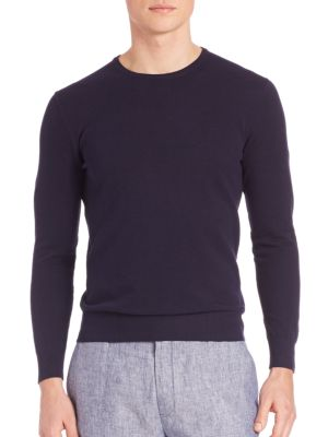 """Image of Solid woolen tee designed for comfort and style. Crewneck. Long sleeves with ribbed cuffs. Ribbed hem. About 25"""" from shoulder to hem. Wool. Dry clean."""