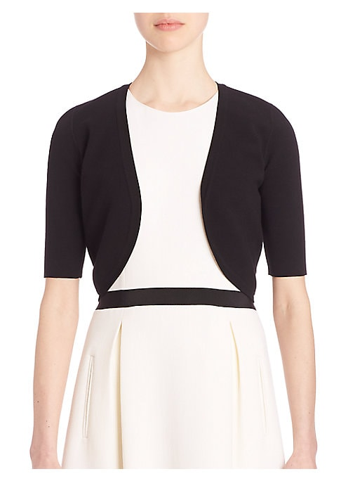 """Image of .Closet staple with a fitted silhouette shrug. Short sleeves. Open front. About 15"""" from shoulder to hem. Viscose/polyester. Dry clean. Imported. Model shown is 5'10"""" (177cm) wearing size Small."""