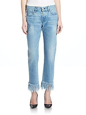 "Image of Attached fringe elevates these chic selvedge jeans Belt loops Button fly Five-pocket style Distressed details Attached fringe at hem Relaxed fit Inseam, about 28"" Cotton Machine wash Made in USA Model shown is 5'10"" (177cm) and wearing US size 4. Contempo"